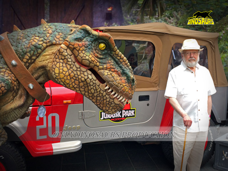 T-Rex Costume standing in front of Jurassic Car