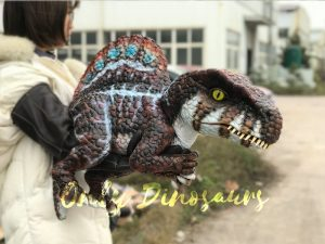 Brown Adorable Spinosaurus puppet sits on the hand