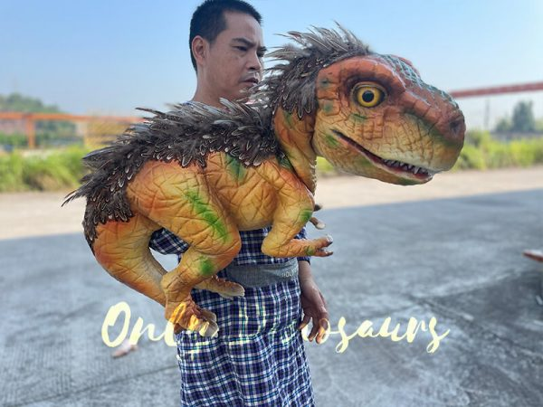 A Man Carrying the Feathered Baby T-Rex