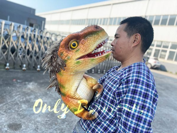 A Man Carrying in a Feathered Baby T-Rex
